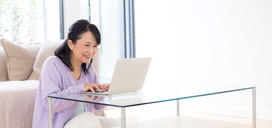 Happy woman at computer