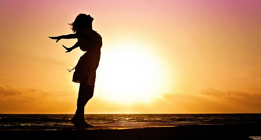 happy woman in sunset